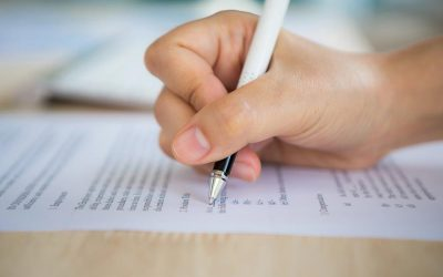 hand-with-pen-writing-paper